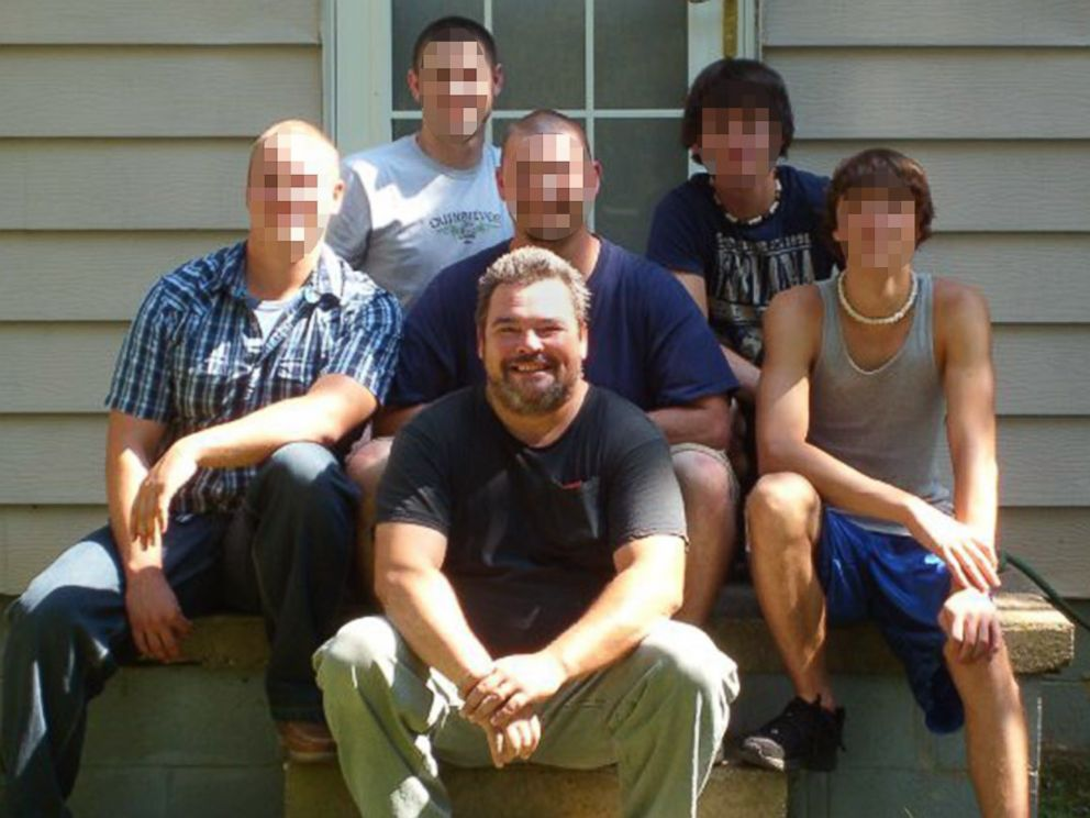 PHOTO: Howard Eubank, front, poses for a photo with his sons in this undated family photo. Eubanks was killed by his wife, Marcia Eubank, who lived with his dismembered body in their Ohio home for several months before being discovered.