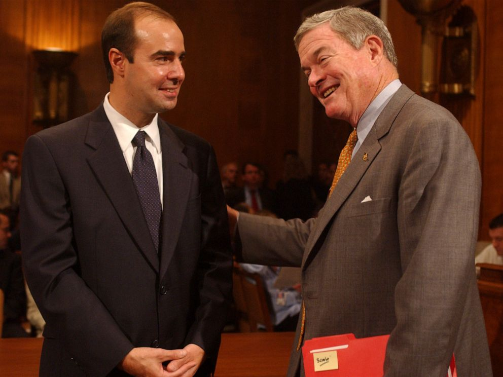 PHOTO: Eugene Scalia, left, nominee for Solicitor of Labor, gets encouragement from Sen. Kit Bond, before a conformation hearing, Oct. 2, 2001, in Washington, DC.