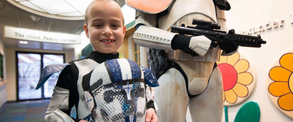 """PHOTO: Evan, 8, holds his proton beam mask that has been painted to resemble a Stormtrooper helmet from the """"Star Wars"""" movies by an employee of St. Louis Childrens Hospital."""