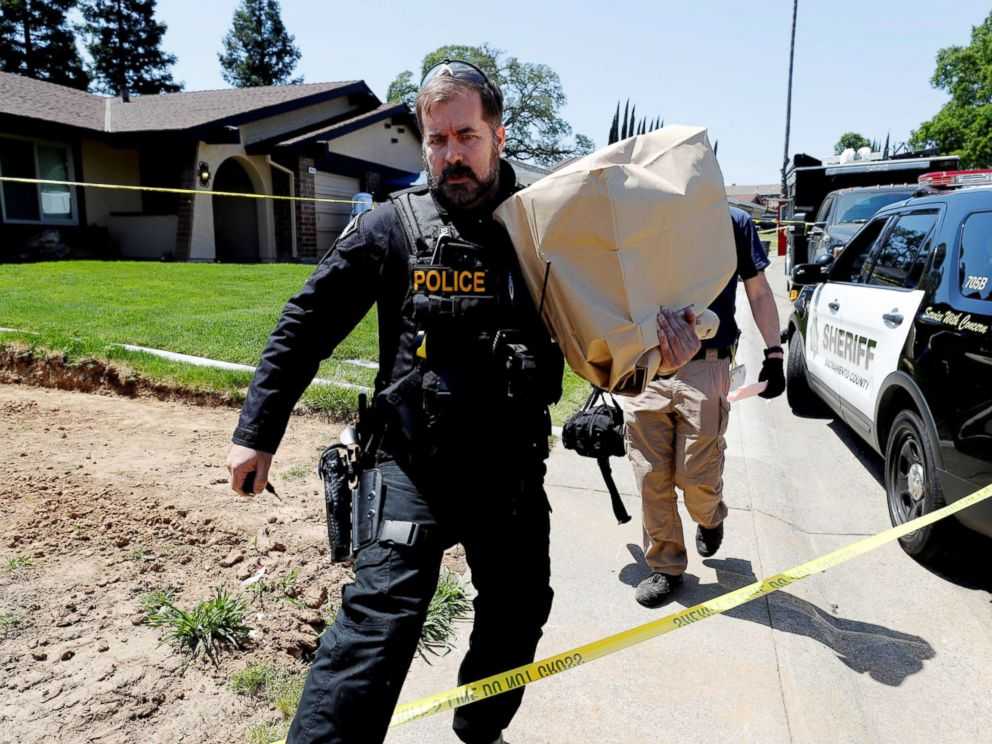 PHOTO: A police officer removes items in evidence bags from the home of Joseph James Deangelo, in Citrus Heights, Calif, April 26, 2018.