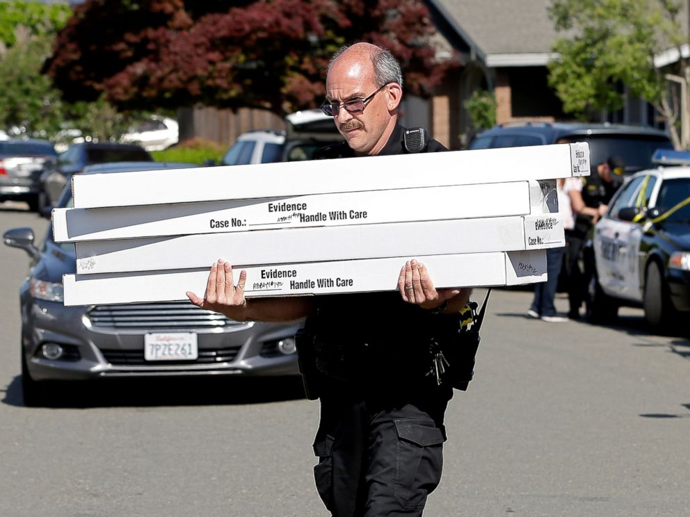 PHOTO: John Lopes, a crime scene investigator for the Sacramento County Sheriffs office, carries boxes of evidence taken from the home of murder suspect Joseph DeAngelo to a sheriffs vehicle, April 26, 2018, in Citrus Heights, Calif.