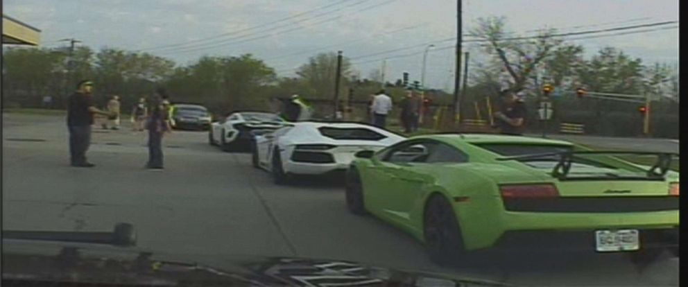 PHOTO: Dashcam footage caught a line of exotic cars speeding down the highway.
