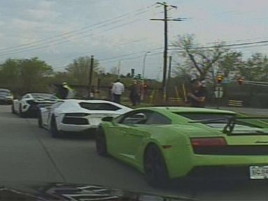 Police dashcam captures pack of exotic sports cars speeding