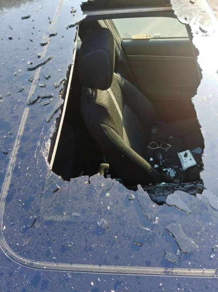 PHOTO: damage to a car roof from an exploding dry shampoo can