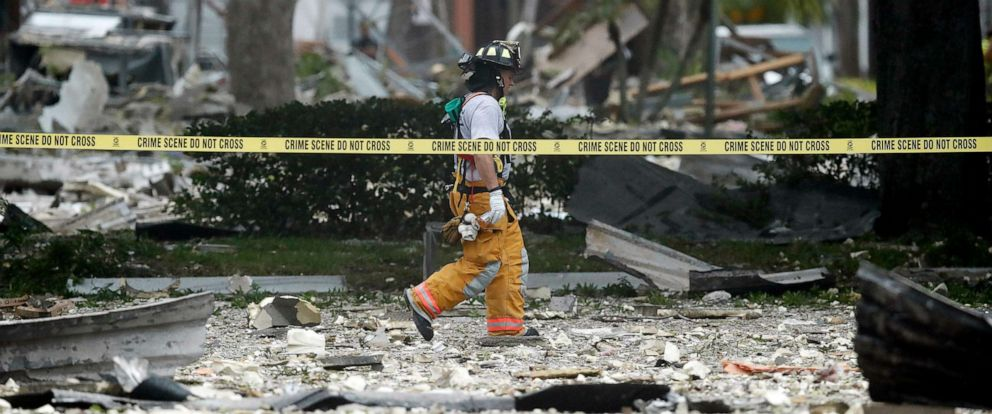 PHOTO:A firefighter walks through the remains of a building after an explosion, July 6, 2019, in Plantation, Fla.