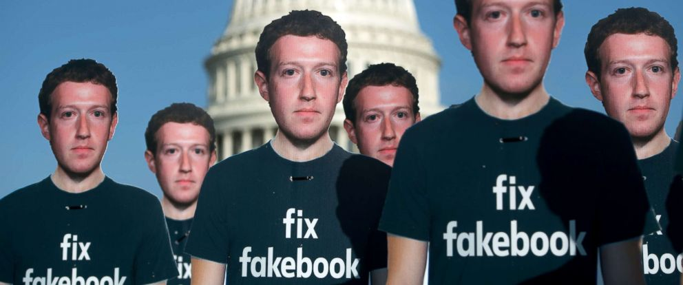 Cardboard cutouts of Facebook founder and CEO Mark Zuckerberg stand outside the U.S. Capitol in Washington, April 10, 2018. Facebook said on Tuesday its removed more pages linked to suspicious activity in Russia and Iran.