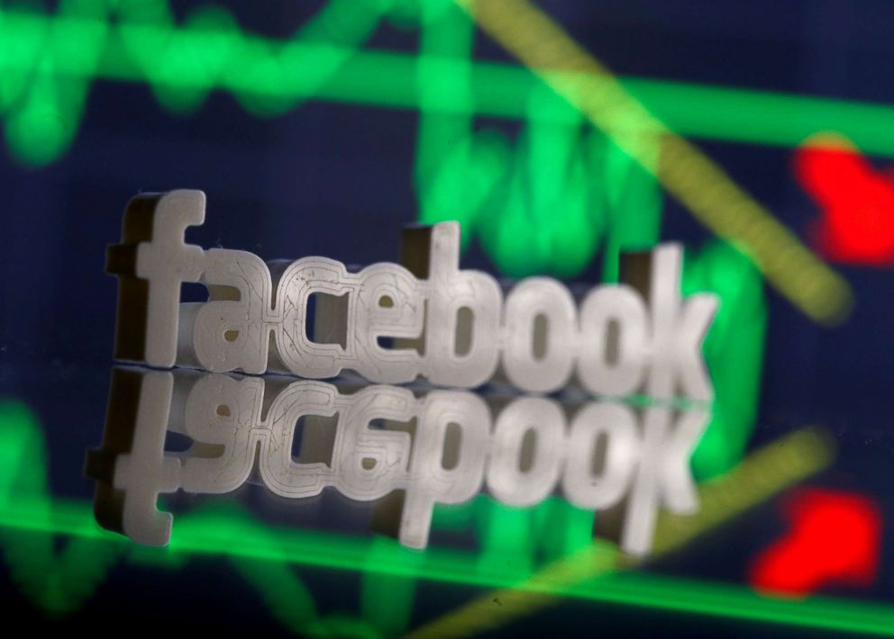 PHOTO: A 3D-printed Facebook logo is seen in front of displayed stock graph in this illustration photo, March 20, 2018.