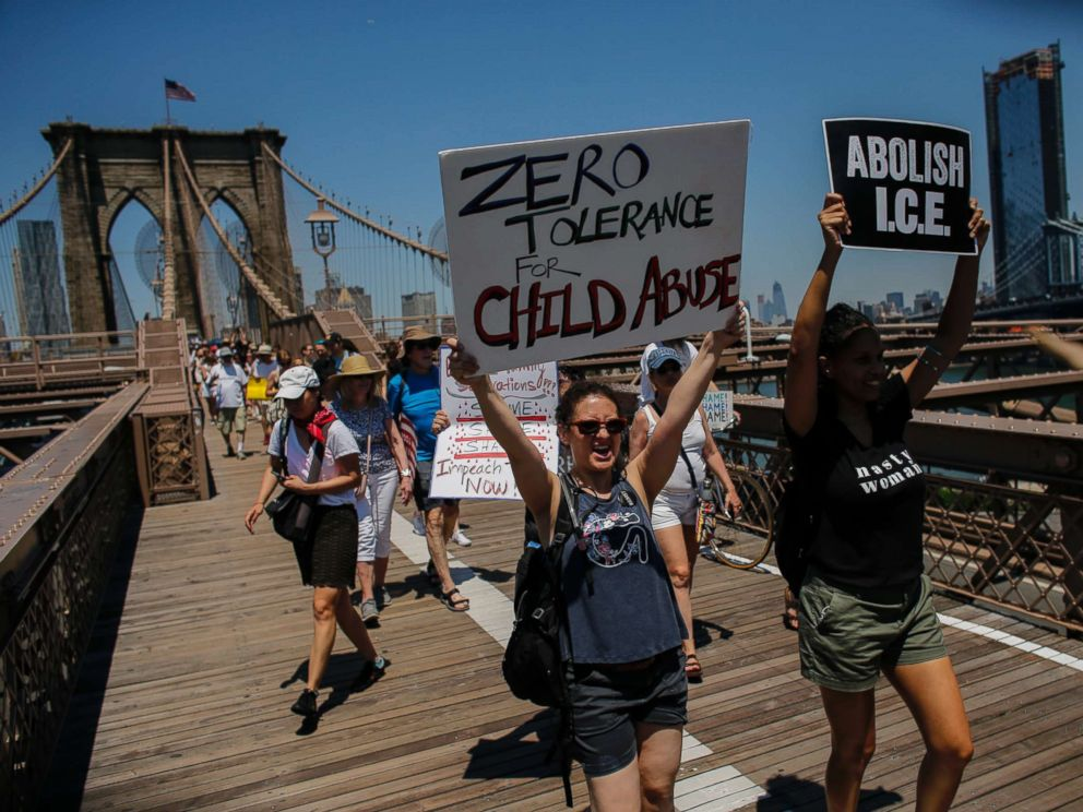 PHOTO: People take part during the nationwide Families Belong Together march as they walk by the Brooklyn Bridge on June 30, 2018 in New York City.