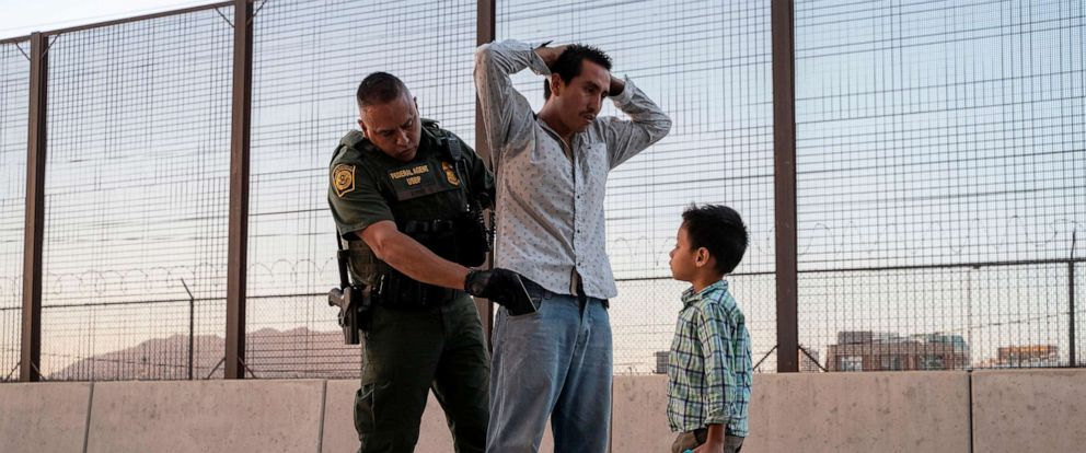 PHOTO: Jose, 27, with his son Jose Daniel, 6, is searched by US Customs and Border Protection Agent Frank Pino, May 16, 2019, in El Paso, Texas.