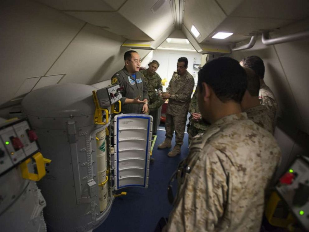 PHOTO: Lt. Fan Yang, left, a tactical coordinator assigned to Patrol Squadron (VP) 5, demonstrates the systems onboard a P-8A Poseidon aircraft to members of the Royal Saudi Naval Forces in an undisclosed location, March 1, 2018.