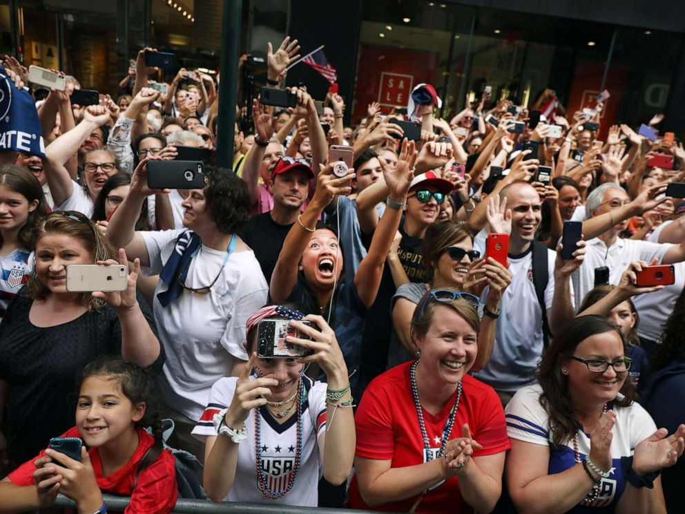 PHOTO: Fans cheer as members of the U.S. Womens National Soccer Team travel down the Canyon of Heroes in a ticker tape parade, July 10, 2019, in New York City.