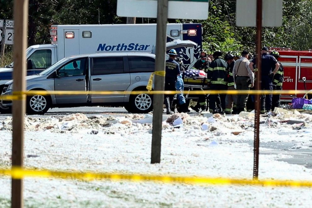 PHOTO: In an image from video, a flag-draped body is moved to a coroners vehicle at the scene of an explosion, Sept. 16, 2019, in Farmington, Maine.