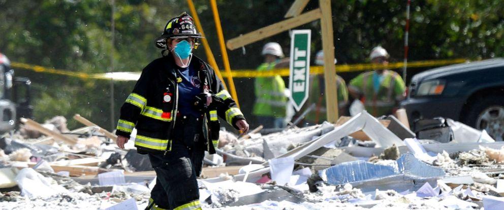 PHOTO: A firefighter walks through the scene of an explosion, Sept. 16, 2019, in Farmington, Maine.