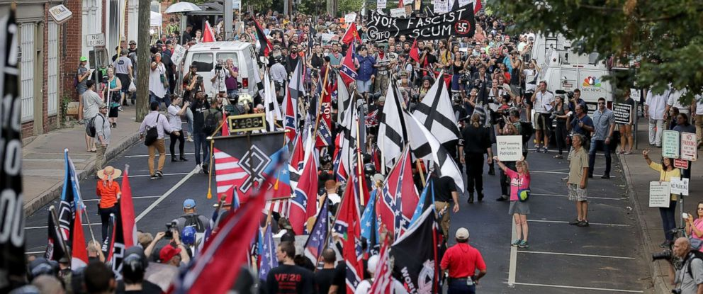"PHOTO: Hundreds of white nationalists, neo-Nazis and members of the ""alt-right"" march down East Market Street toward Emancipation Park and confront anti-fascist protesters August 12, 2017 in Charlottesville, Virginia."