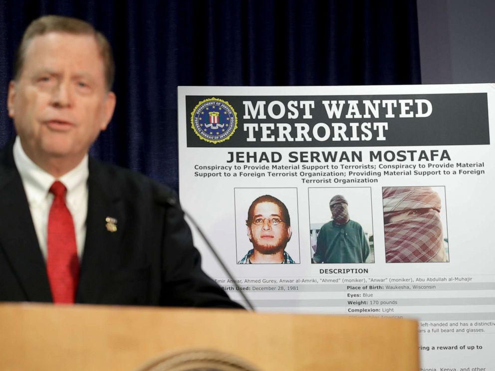 PHOTO: U.S Attorney Robert Brewer speaks in front of an FBI poster depicting Jehad Serwan Mostafa during a news conference Monday, Dec. 2, 2019, in San Diego.