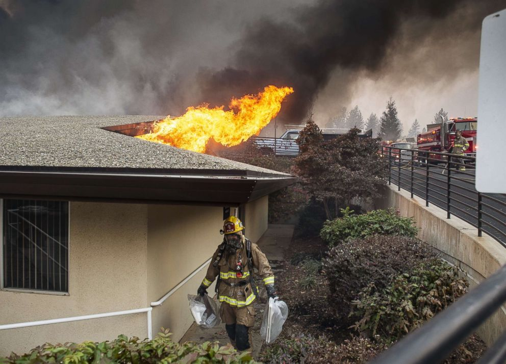 PHOTO: A firefighter removes belongings from the Adventist Feather River hospital radiology building, which was fully engulfed in flames in Paradise, Calif., during the Camp Fire on Nov. 8, 2018.