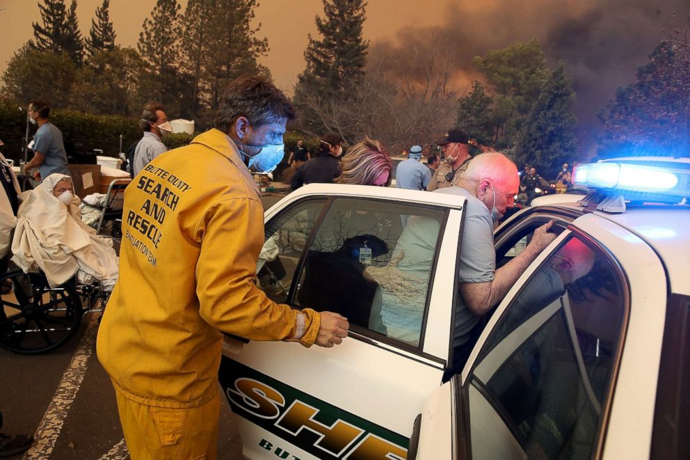 Hospital workers and first responders evacuate patients from the Feather River Hospital as the Camp Fire moves through the area on Nov. 8, 2018 in Paradise, Calif.