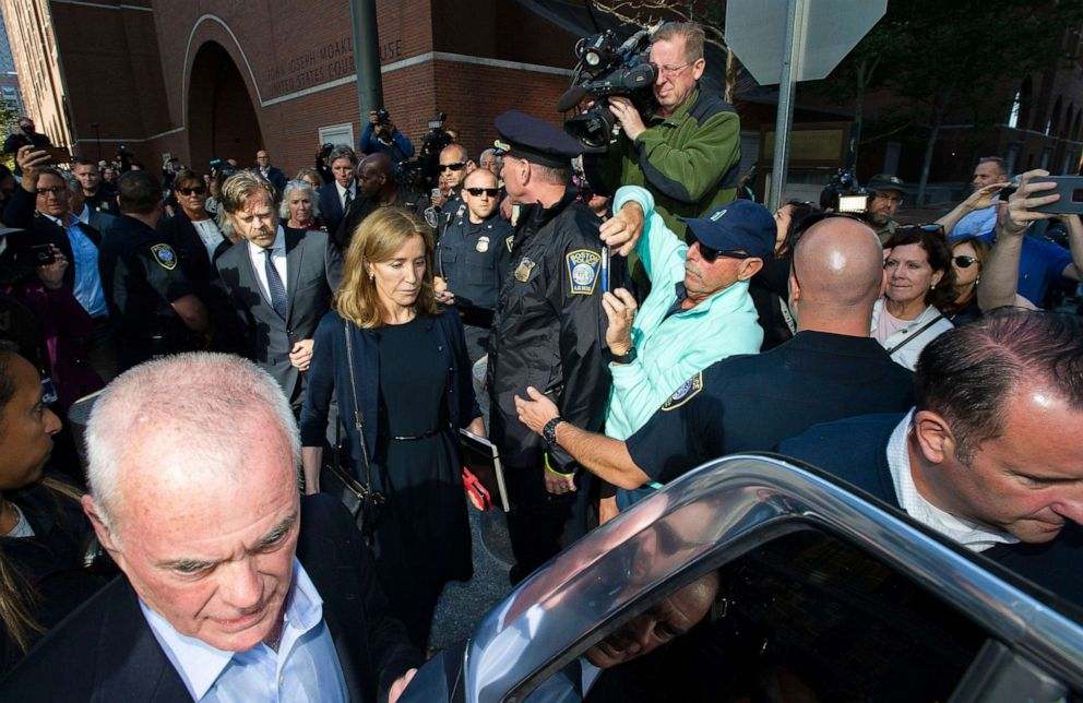 PHOTO: Actress Felicity Huffman, escorted by her husband William H. Macy, makes her way to a waiting SUV after leaving the courthouse in Boston, where she was sentenced for her role in the College Admissions scandal on September 13, 2019.