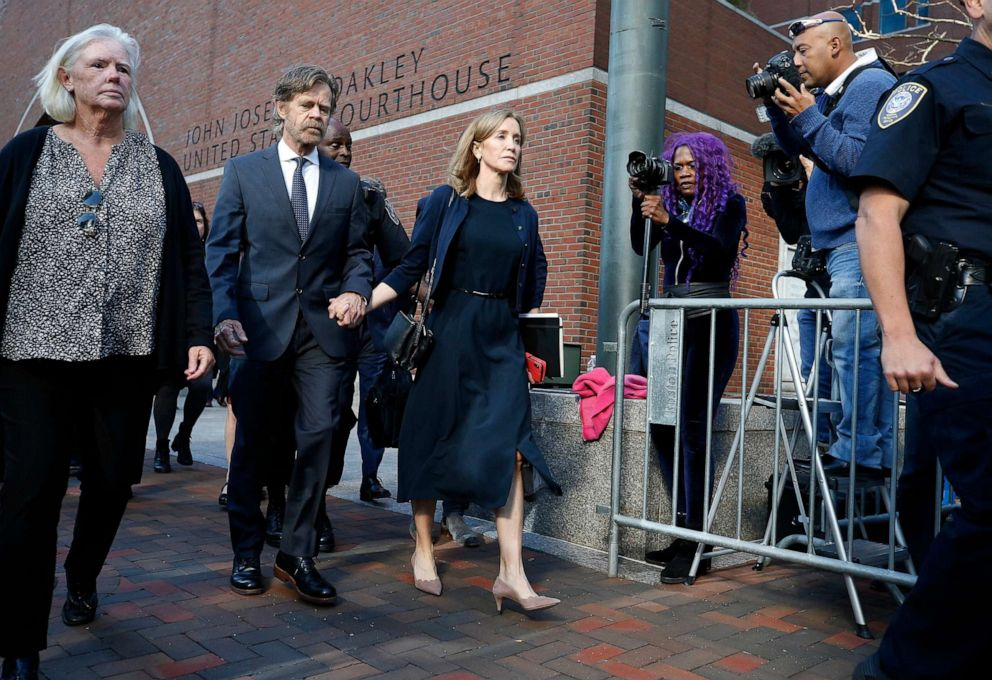PHOTO: Felicity Huffman leaves federal court with her husband William H. Macy after she was sentenced in a nationwide college admissions bribery scandal, Friday, Sept. 13, 2019, in Boston.
