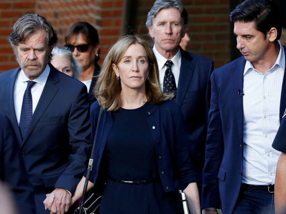 PHOTO: Actress Felicity Huffman, center, leaves the federal courthouse with her husband William H. Macy after being sentenced in connection with a nationwide college admissions cheating scheme in Boston, M.A., on Sept. 13, 2019.