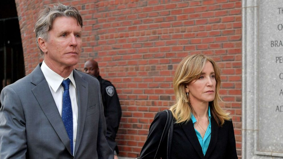 Felicity Huffman exits the John Joseph Moakley U.S. Courthouse after appearing in Federal Court to answer charges stemming from college admissions scandal, April 3, 2019,in Boston.
