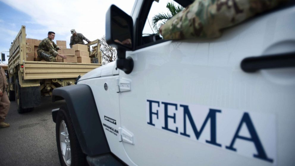 Department of Homeland Security personnel deliver supplies to Santa Ana community residents in the aftermath of Hurricane Maria in Guayama, Puerto Rico, Oct. 5, 2017.