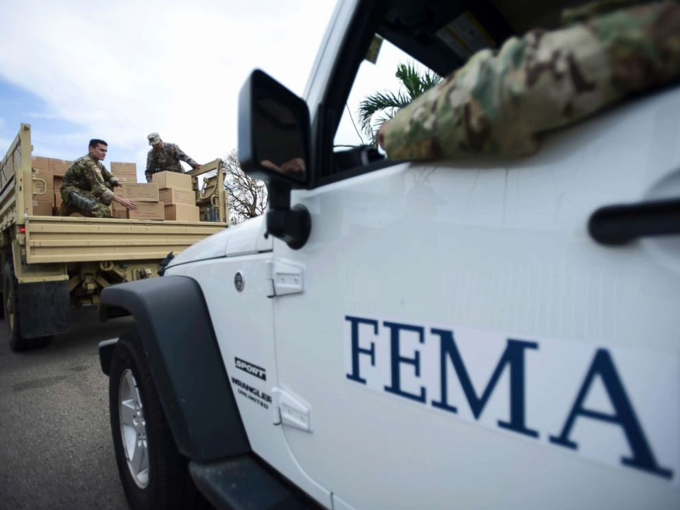 PHOTO: Department of Homeland Security personnel deliver supplies to Santa Ana community residents in the aftermath of Hurricane Maria in Guayama, Puerto Rico, Oct. 5, 2017.