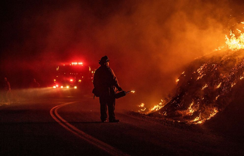 PHOTO: A firefighter lights a back fire during the Kincade fire near Geyserville, California on October 24, 2019.
