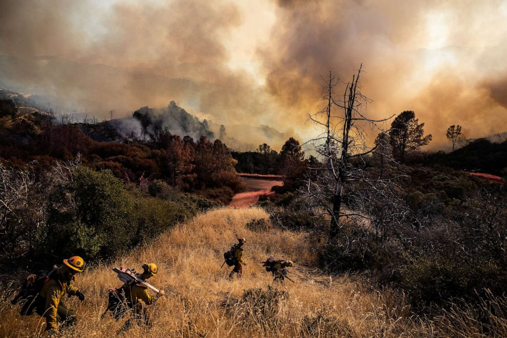 PHOTO: Firefighters with the Marin County Fire Department begin to dig a containment line ahead of the Kincade Fire, in the Geysers, a geothermal field in California on Friday, Oct. 25, 2019.
