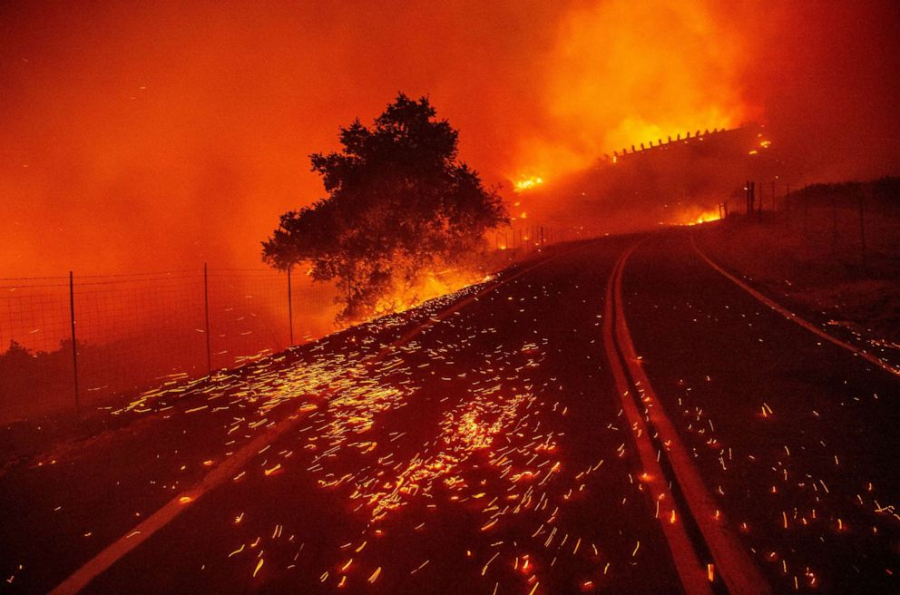 PHOTO: Embers blow across a road as wind rips through the area during the Kincade Fire near Geyserville, California on October 24, 2019.