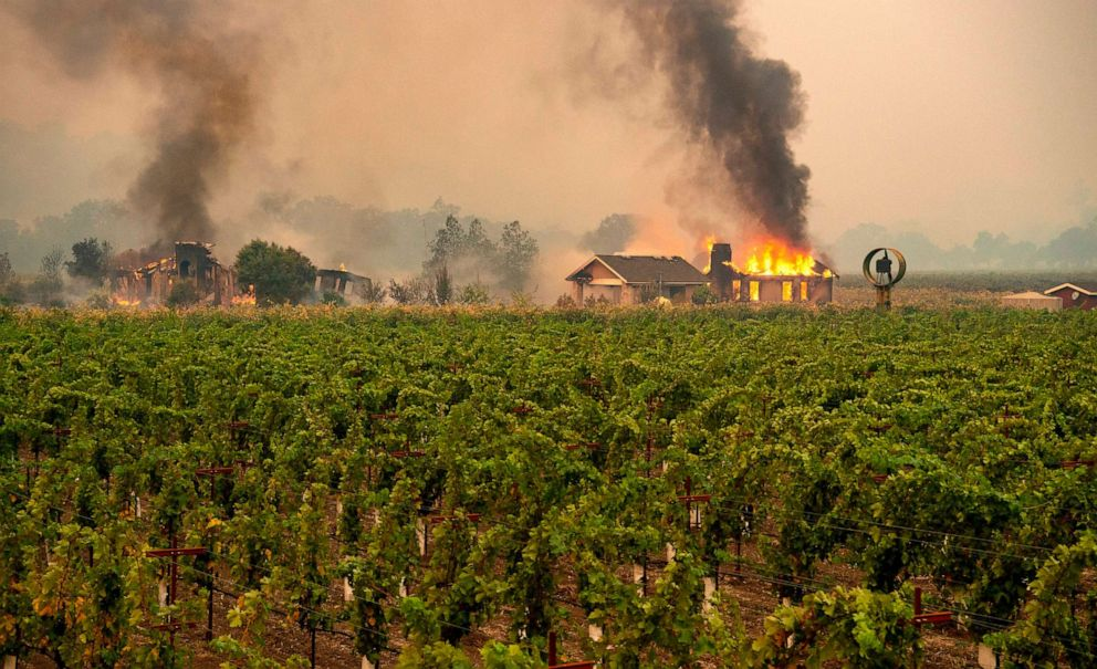 PHOTO: A building is engulfed in flames at a vineyard during the Kincade fire near Geyserville, California on October 24, 2019.