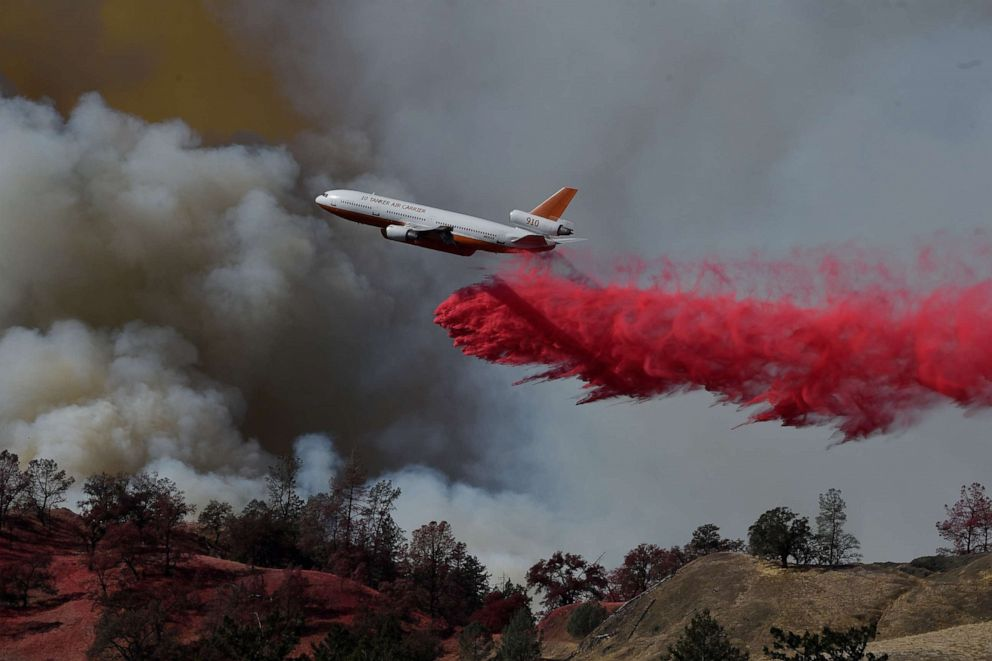 PHOTO: A fire fighting aircraft intervene in a fire broke out at Geyserville town in Sonoma County, California, United States on October 25, 2019.