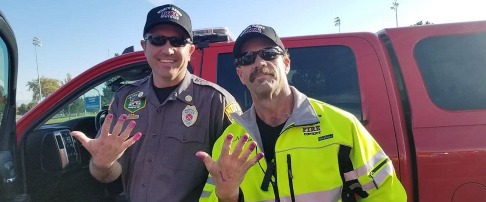 PHOTO: Two firemen from the North Davis Fire District show off their manicured nails after helping a young girl.