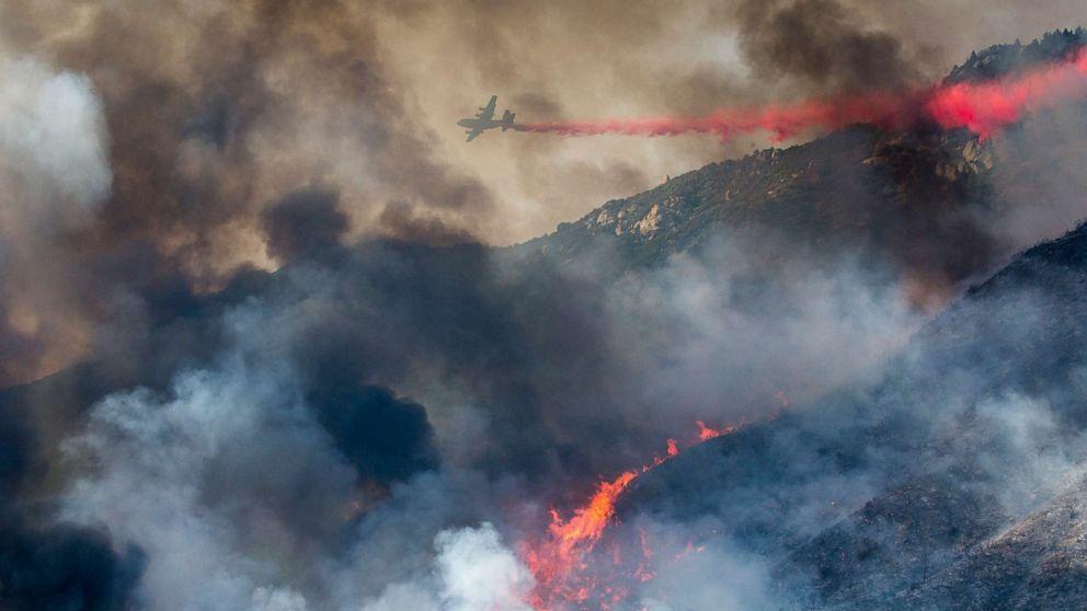 PHOTO: An air tanker drops retardant at a wildfire burns at a hillside in Yucaipa, Calif., Sept. 5, 2020.