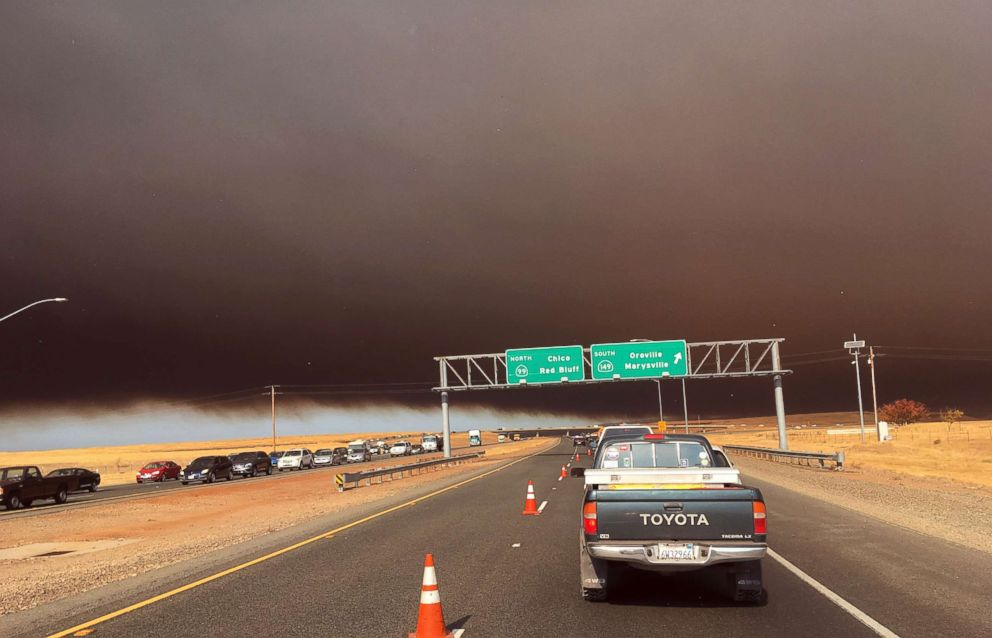 PHOTO: Smoke from the Camp Fire, burning in the Feather River Canyon near Paradise, Calif., darkens the sky as seen from Highway 99 near Marysville, Calif., Nov. 8, 2018.