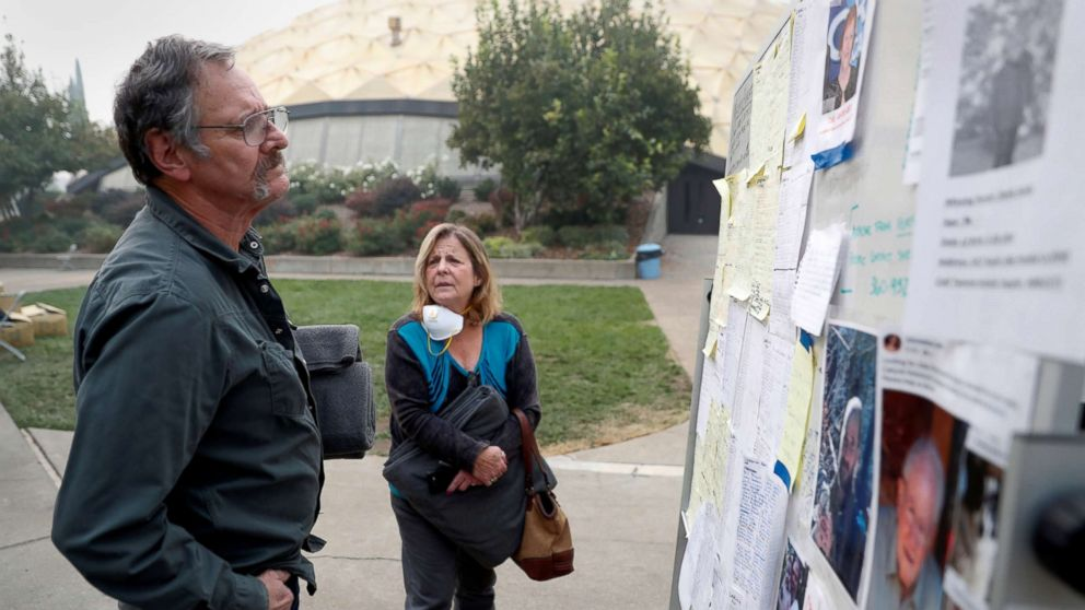 Lane and Julie Walker, of Magalia, look for people they know on a list of people missing in the aftermath of the Camp Fire in Chico, Calif., Nov. 15, 2018.