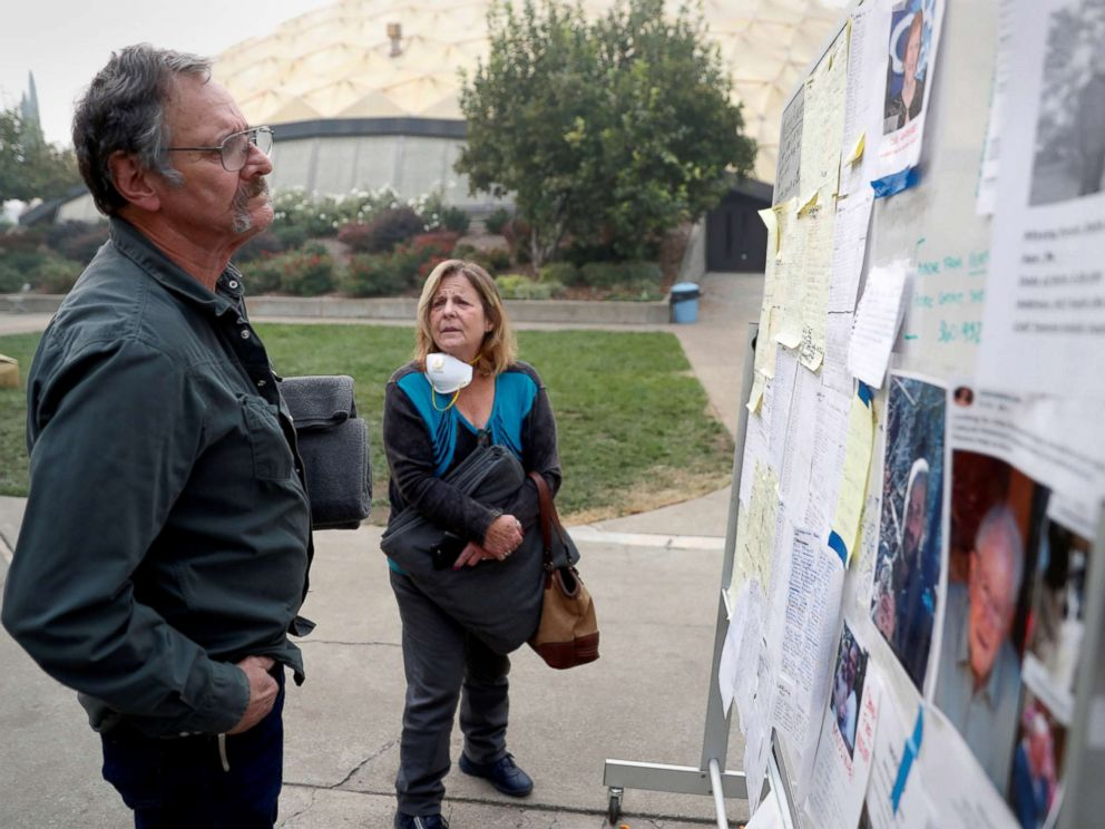 PHOTO: Lane and Julie Walker, of Magalia, look for people they know on a list of people missing in the aftermath of the Camp Fire in Chico, Calif., Nov. 15, 2018.