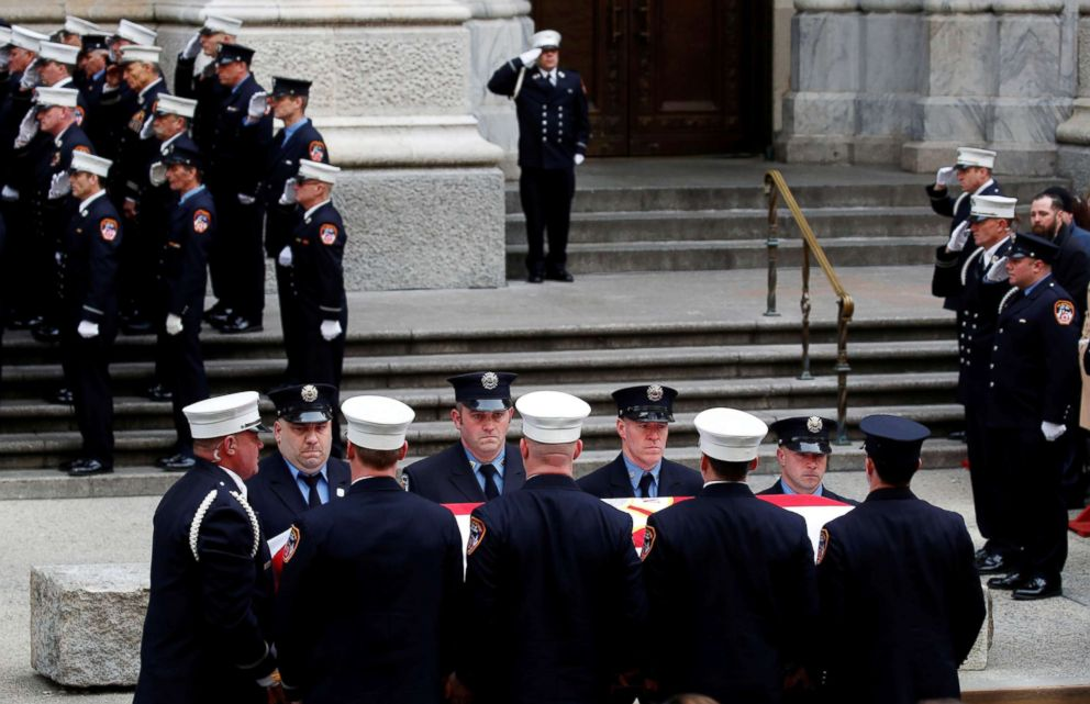 PHOTO: Pall bearers carry the casket with New York City Fire Department Lieutenant Michael R. Davidson into St. Patricks Cathedral for his funeral in Manhattan in New York City, March 27, 2018.