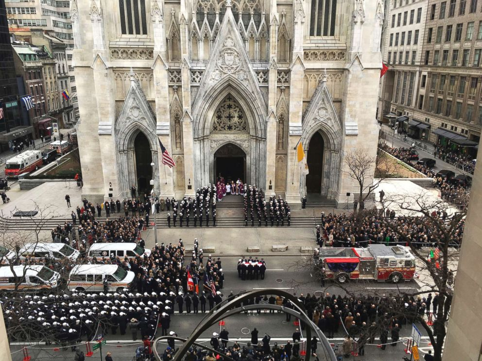 PHOTO: A casket carrying the body of Lt. Michael Davidson is carried into New Yorks St. Patricks Cathedral as mourners gathered, March 27, 2017, for the funeral services.