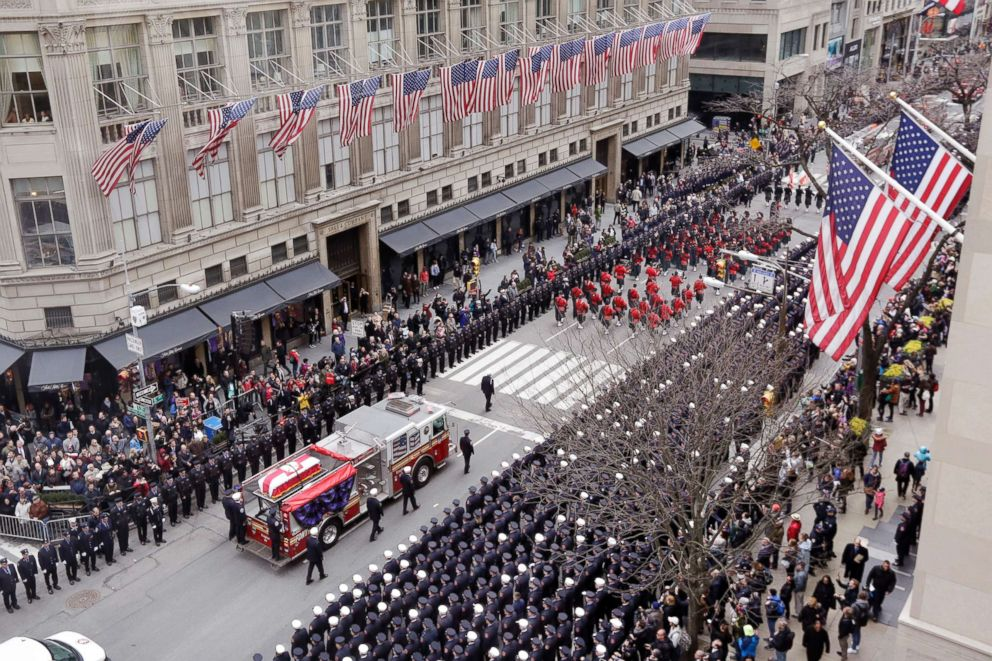 PHOTO: The casket of New York City firefighter Michael Davidson is carried on a fire truck down Fifth Avenue as it leaves St. Patricks Cathedral after his funeral, in New York, March 27, 2018.