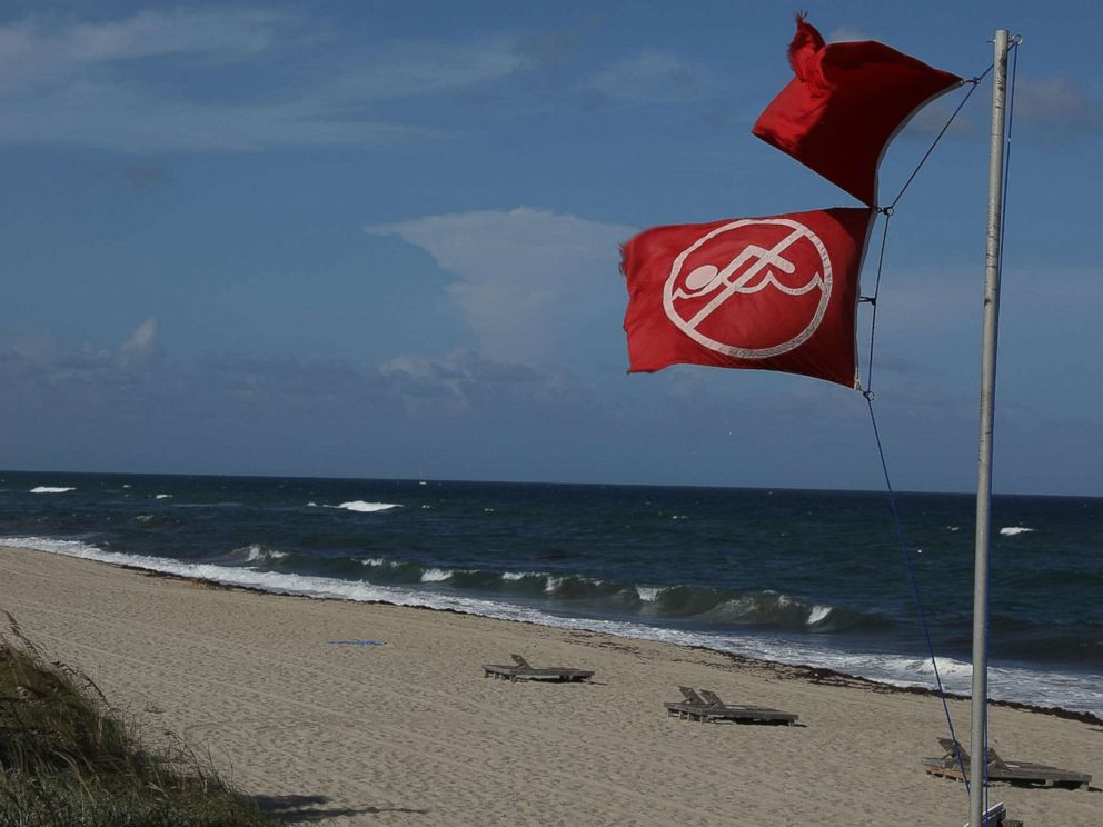 PHOTO: A lifeguards no swimming flag flies above a beach as Palm Beach County as officials announced that all county beaches are closed due to red tide affecting coastal areas on Oct. 4, 2018 in Lake Worth, Fla.