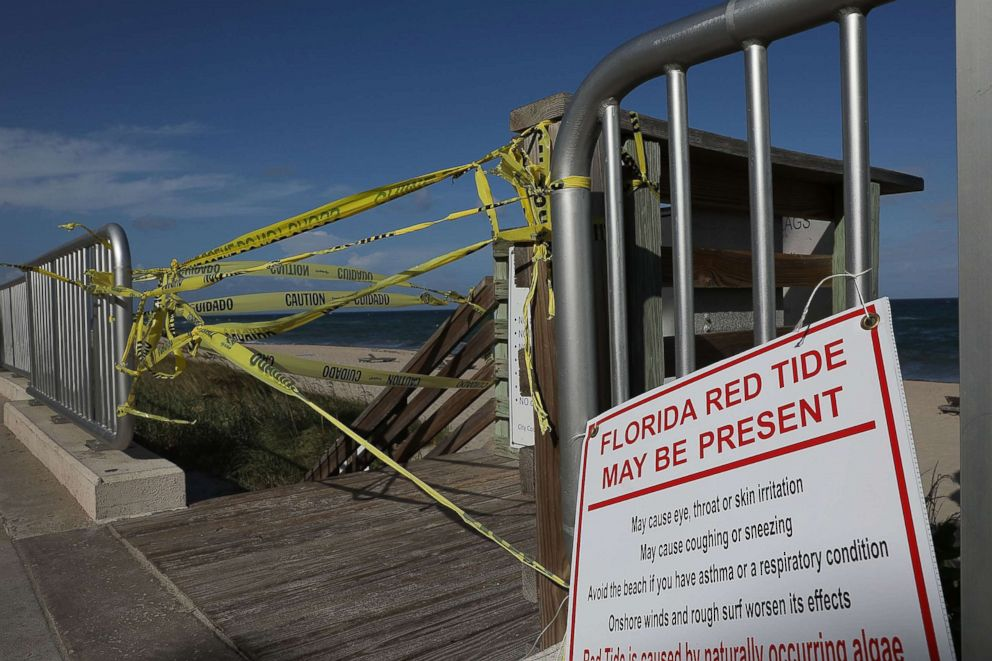 PHOTO: Caution tape closes off an entrance to the beach as Palm Beach County officials announced that all county beaches are closed due to red tide affecting coastal areas on Oct. 4, 2018 in Lake Worth, Fla.