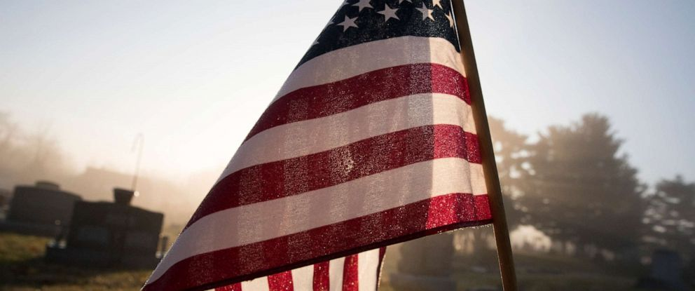 PHOTO: An American flag flies at a grave in this stock photo.