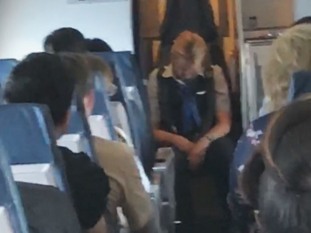 PHOTO: An image made from video shot on board a United Express flight from Chicago to East Bend, Ind., on Aug. 2, 2019, shows a flight attendant who was later charged with criminal public intoxication.