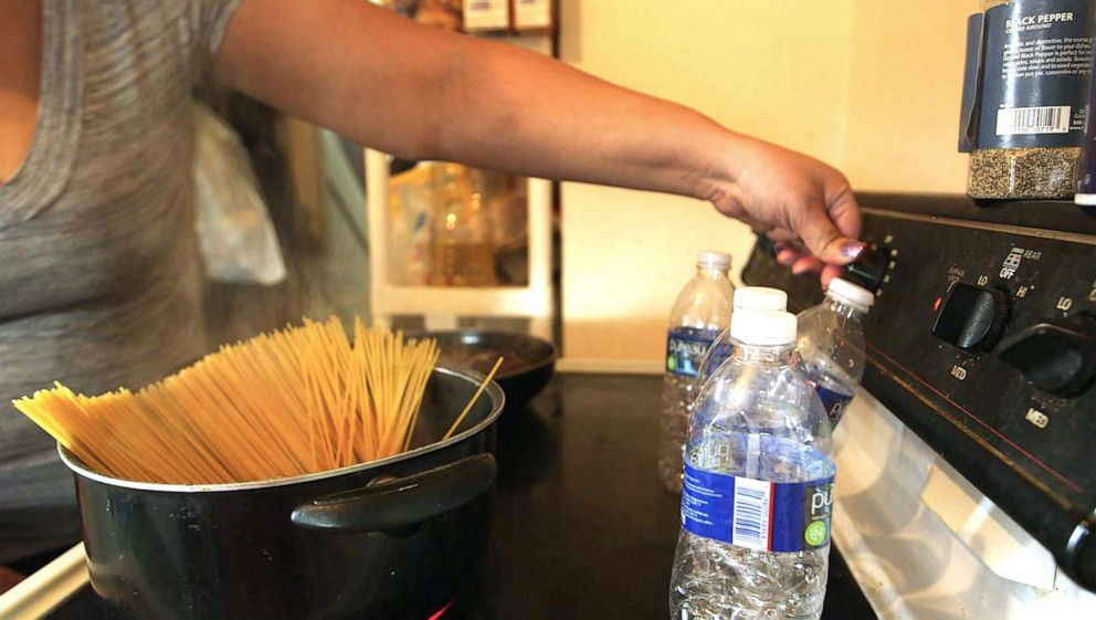 PHOTO: Jamie Marshall says she wont use the water in Flint, Mich., for cooking, so she uses four bottles of water to boil spaghetti for dinner.