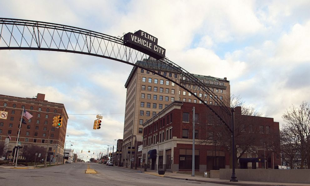 PHOTO: A Flint Vehicle City sign stands on Saginaw Street in downtown Flint, Mich.
