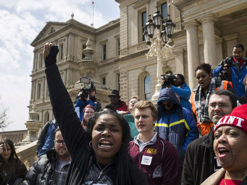 PHOTO: Ariana Hawk of Flint, Michigan, leads a chant during a protest on the steps of the Michigan State Capitol on April 11, 2018 in Lansing, Michigan.