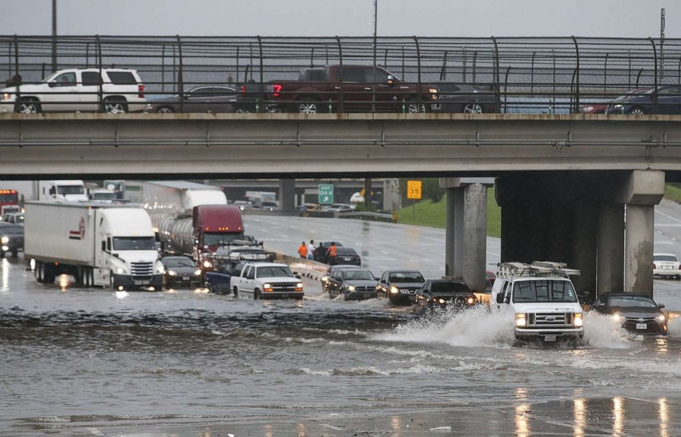 PHOTO: Cars pull to the side of the freeway of highway 69 North to get by the flood waters on September 19, 2019 in Houston, Texas.