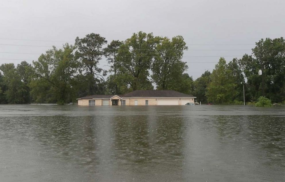 PHOTO: Remnants of Tropical Depression Imelda flood a home on Thursday, Sept. 19, 2019, near Devers, Texas.