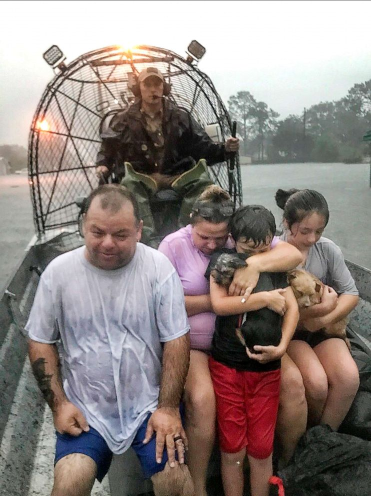 PHOTO: In this photo provided by the Texas Parks & Wildlife Department, a family is rescued via fan boat by a member of the department from the flood waters of Tropical Depression Imelda near Beaumont, Texas, Thursday, Sept. 19, 2019.